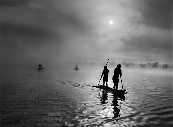 4. In the Upper Xingu region of Brazil's Mato Grosso state, a group of waura fish in the Piulaga Lake near their village. The Upper Xingu Basin is home to an ethnically diverse population. Brazil, 2005.  © Sebastião Salgado / Amazonas Images / nbpictures