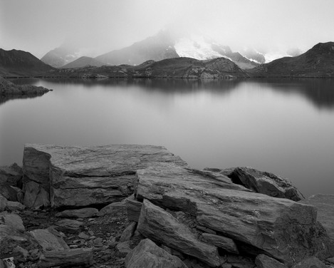 "Photo 10. By removing details on the lake surface grace to a long exposure, the neutral density filter turned an ordinary greyish scenery into the emotional image that I sometimes call ""Icy silence"""