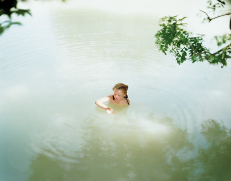 Image 7. Caption: The girl playing innocently in the lake has strong overtones of arcadian purity. Midday, Top Lake. Glyndebourne, East Sussex. Harry Cory Wright