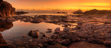 Aeon Flux' – afterglow light at Wembury's wave-channel reef – with the Great mew Stone beyond.
