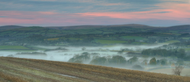 Cloud inversions at dawn below Blakemore Ridge, with Dartmoor beyond. The edge of night and day, the edge of manicured pastoral and rugged moorland.