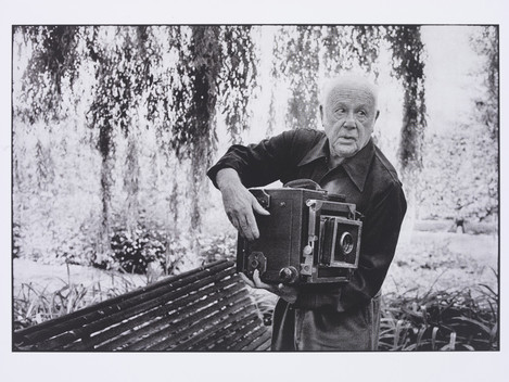 "Martine Franck ""Paul Strand photographing the Orgeval Garden"" 1974. © Martine Franck/Magnum Photos"