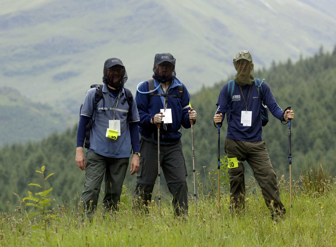 Walkers in the Scottish Highlands wearing Midge Nets to protect them from the infamous Scottish Midge