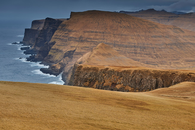 The huge west cliffs of the island of Suðuroy seen from Beinisvørð.