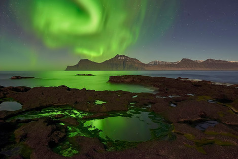 Amazing display of auroras dancing in the night sky of Gjógv.