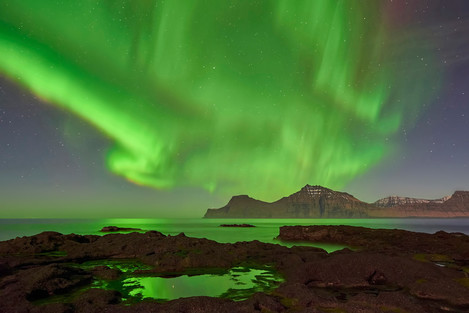 A huge aurora over the mountains of Kalsoy