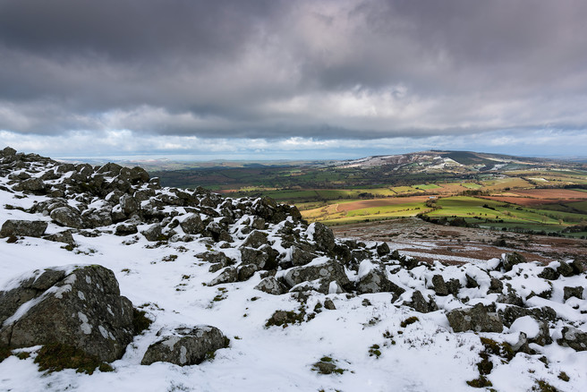 Kate Maxwell - Looking towards Brown Clee (Shropshire's highest point) over the collapsed Bronze Age hillfort wall.