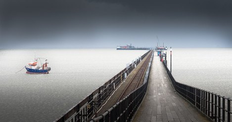 Pier and boat: This is entirely about producing an attractive image.