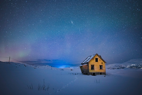 Cold and alone: My initial intent was to produce an attractive image of the hut and the aurora, but in post processing I realised the single line of footsteps in the snow and the stars in the sky created story of being cold and alone.