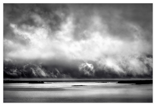 <strong>The Ends of the Earth</strong> is where I live, at the remote eastern tip of Nova Scotia, and this is the view from my studio window as shafts of sunlight spar with storm clouds for dominance over the sea. The ever-changing skyscape here is a constant source of inspiration for my work.